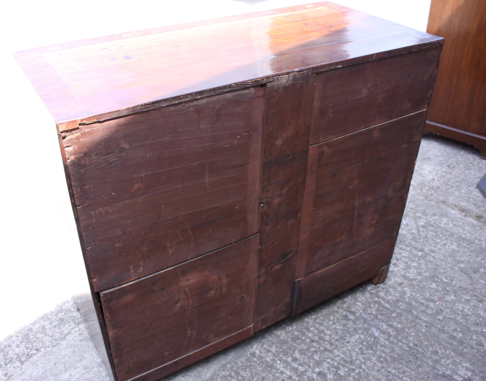 Lot 425 - A Georgian mahogany banded and line inlaid chest of two short and three long drawers with