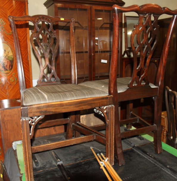 Lot 402 - A set of four 19th century mahogany dining chairs of Chippendale design with pierced splats and