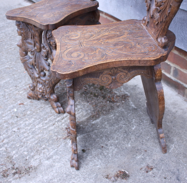 Lot 437 - A pair of Italian Renaissance design carved walnut hall chairs