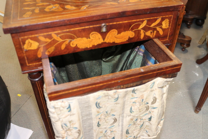 Lot 440 - A 19th century Dutch marquetry work table, fitted drawer and well, on turned columns united by an