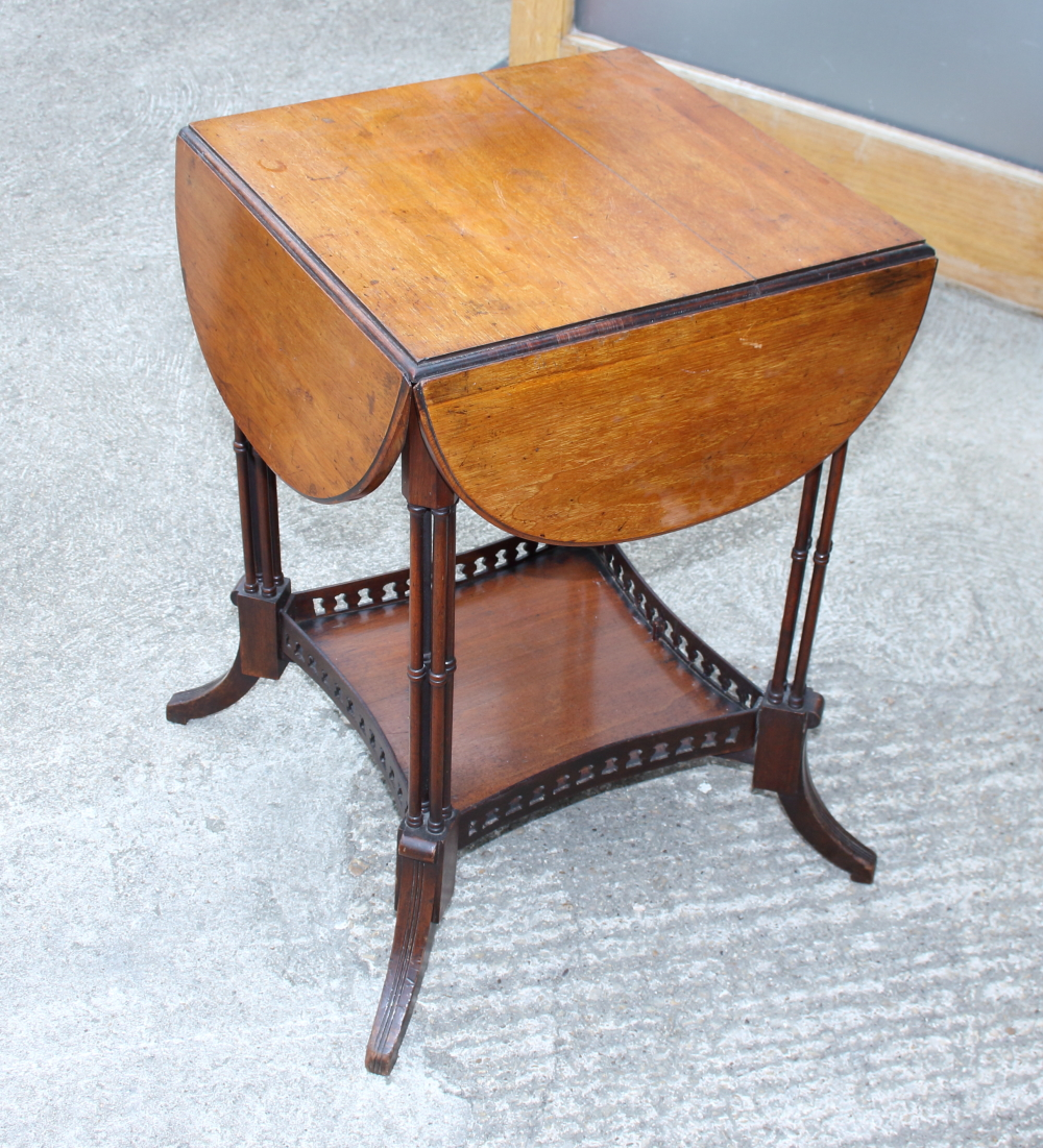 Lot 392 - A late 19th century mahogany quatrefoil drop leaf occasional table, on cluster column supports