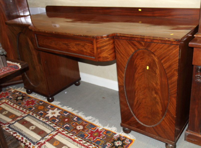 Lot 400 - A Victorian mahogany sideboard with central frieze drawer flanked two panel doors enclosed drawers