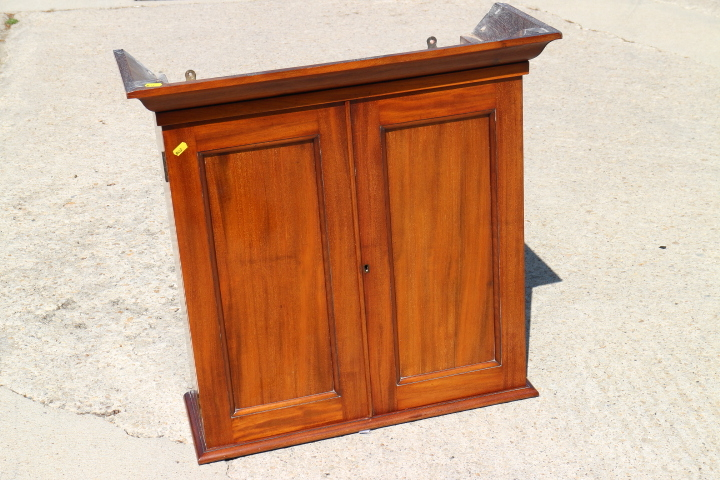 """Lot 412 - A 19th century walnut wall cupboard enclosed two panelled doors, 28"""" wide x 27 3/4"""" high"""