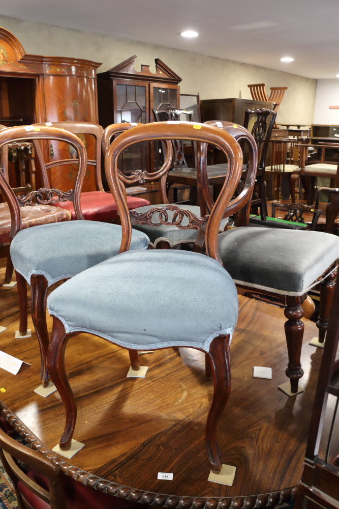 Lot 419 - A Harlequin set of six walnut carved bar back standard dining chairs, upholstered in a blue