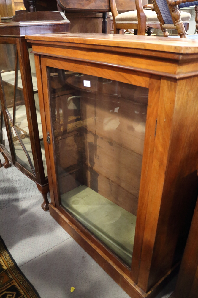 """Lot 429 - A late 19th century walnut pier cabinet enclosed glazed door, on block base, 33"""" wide x 43"""" high"""