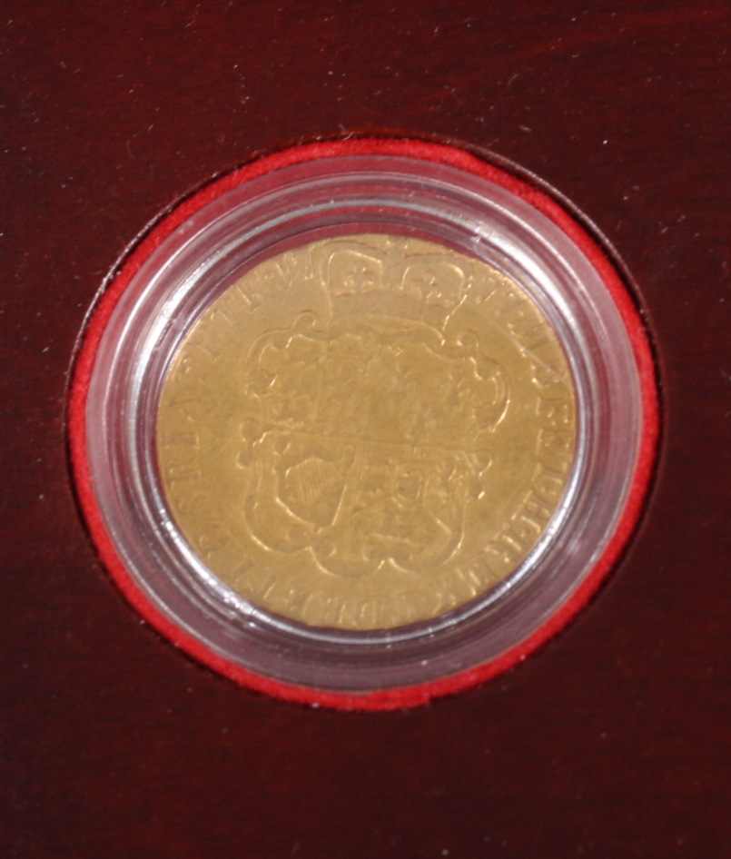 Lot 276 - A George III gold guinea, dated 1977, in fitted presentation box