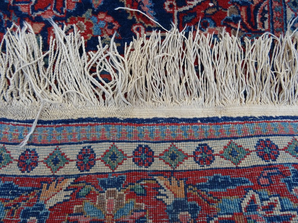 A Kashan rug, Persian, the indigo field with a madder medallion, matching spandrels, - Image 3 of 3