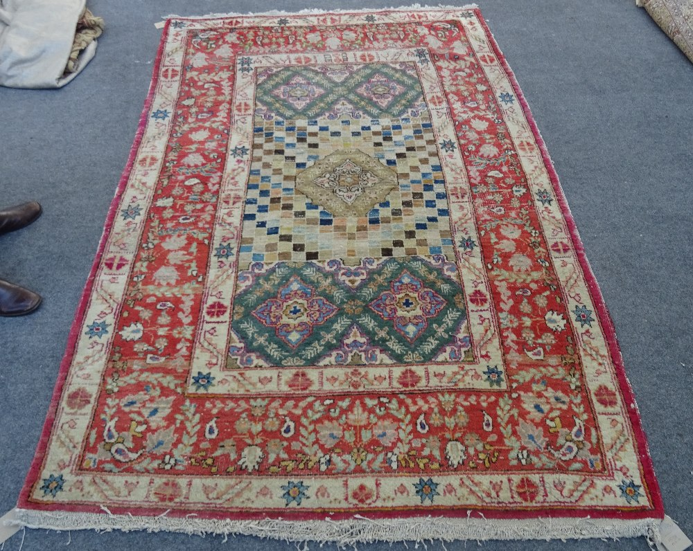 A Mahal rug, the chequered feel with a medallion to the centre,