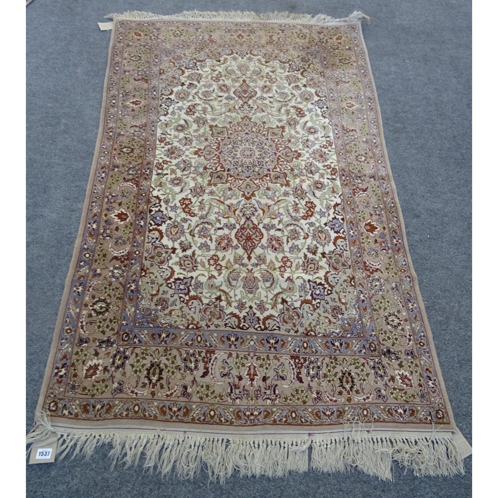Lot 1537 - A fine part silk Esfahan rug, Persian, the ivory field with a brown shaped medallion,