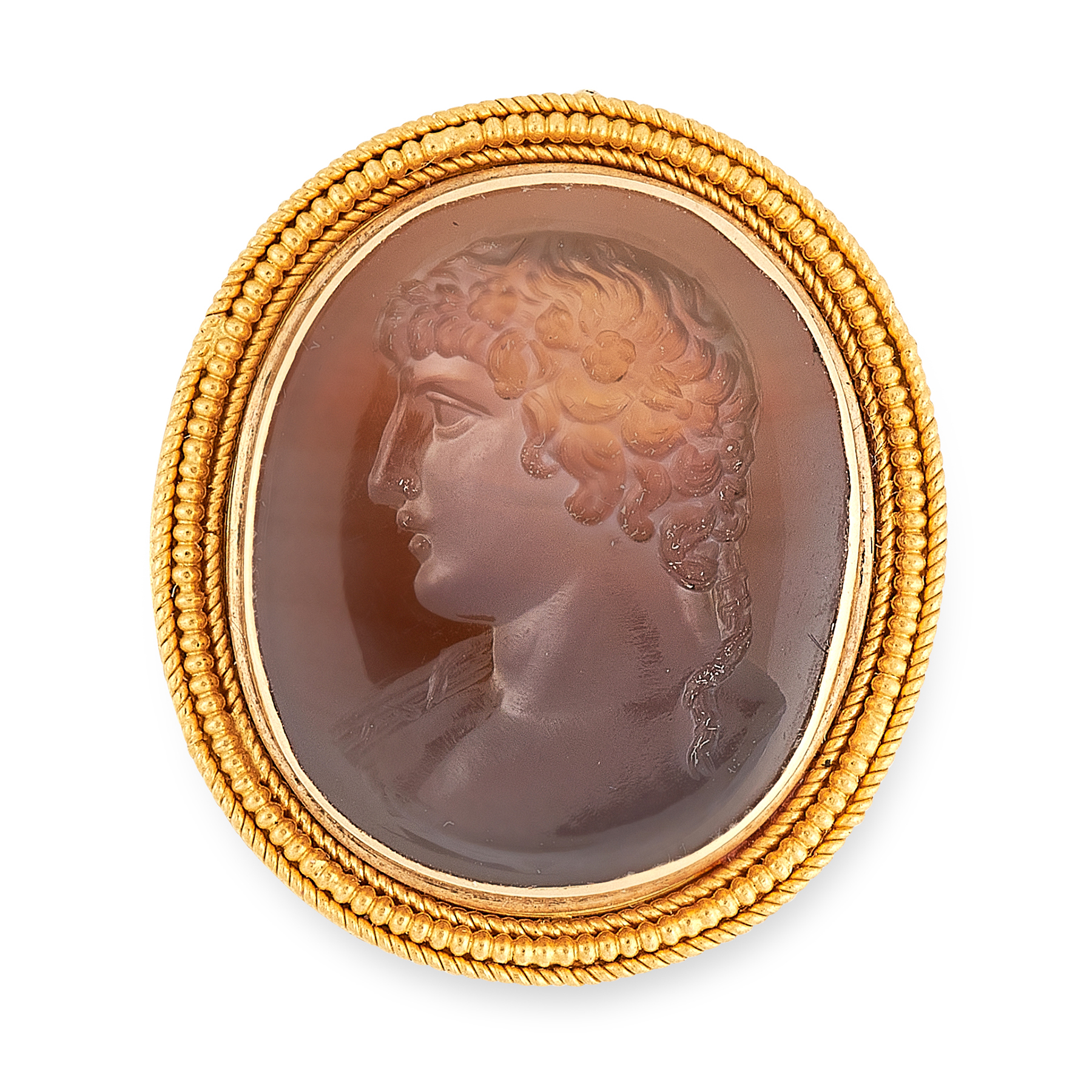 AN ANTIQUE INTAGLIO SEAL BROOCH in high carat yellow gold, the oval face set with a carved hardstone