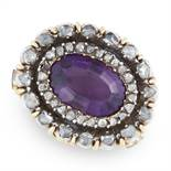 AN AMETHYST AND DIAMOND CLASP in yellow gold and silver, set with an oval cut amethyst within a