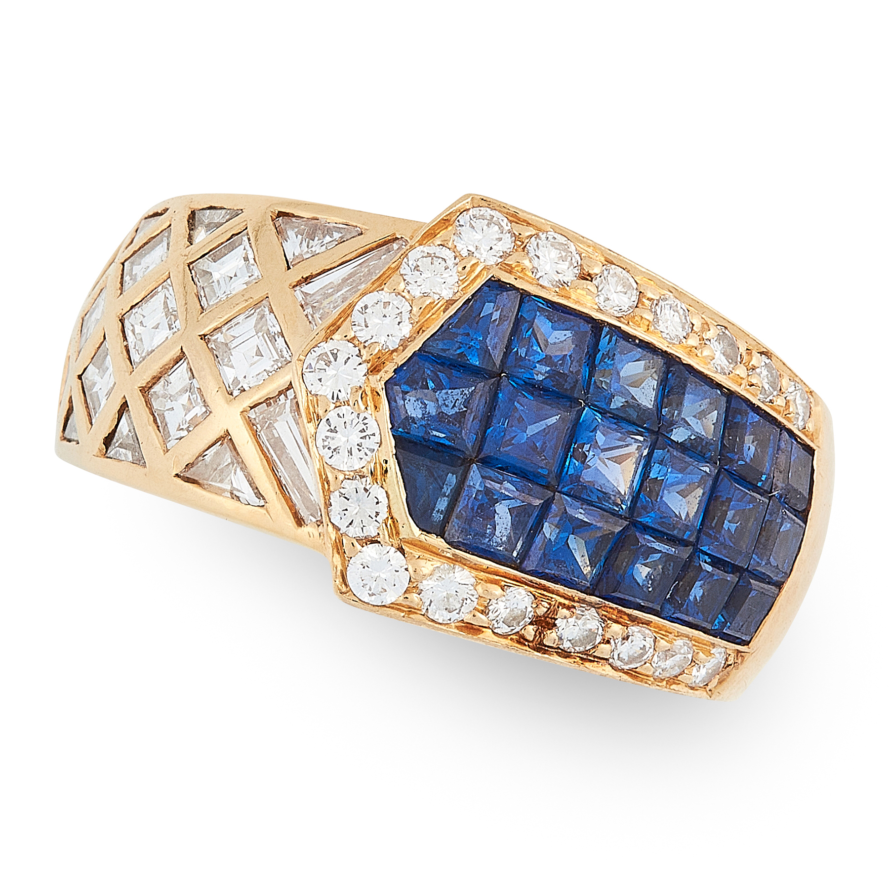 A SAPPHIRE AND DIAMOND DRESS RING in 18ct yellow gold, the tapered overlapping body mystery set with