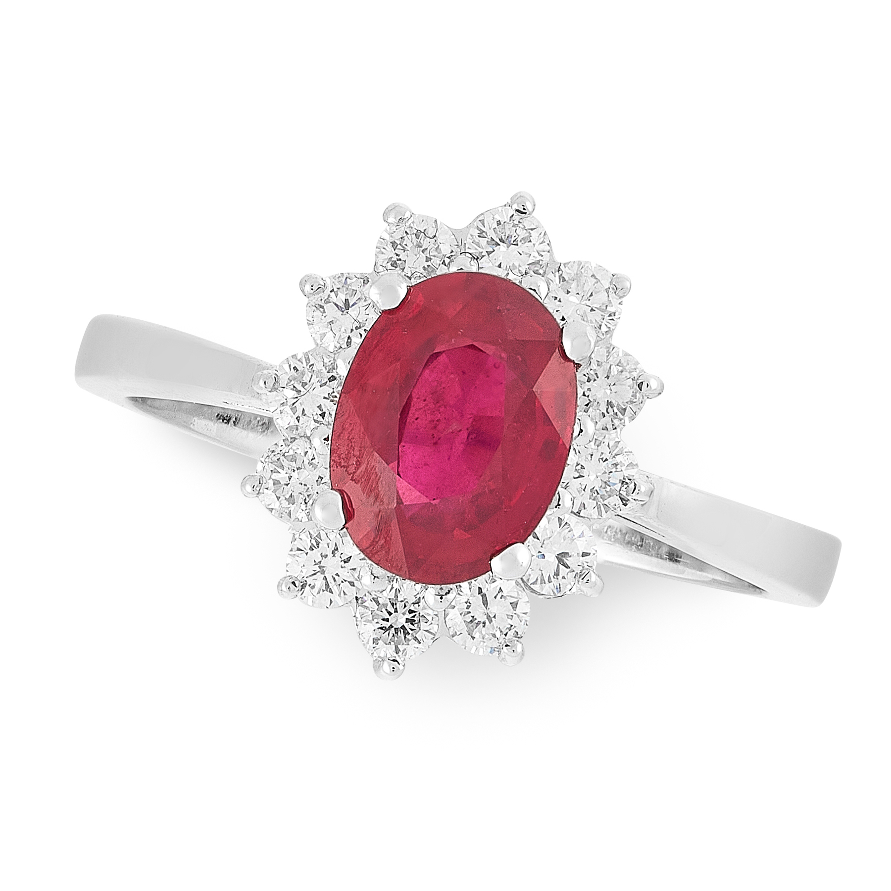 A RUBY AND DIAMOND RING in 18ct white gold, set with an oval cut ruby of 1.89 carats within a border