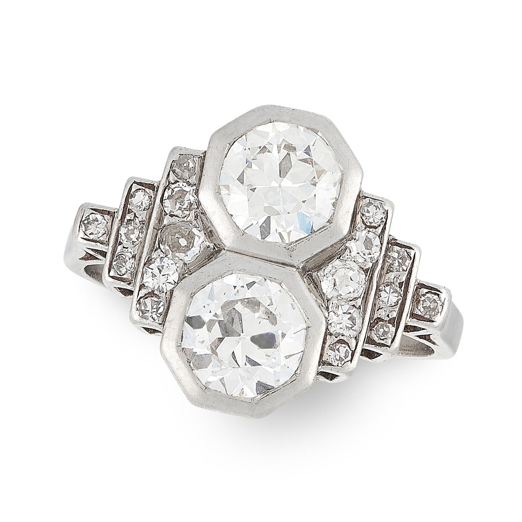 AN ART DECO DIAMOND RING, CIRCA 1935 in platinum, set with two principal old cut diamonds of 0.72