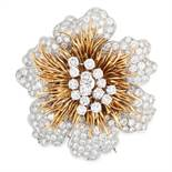 A VINTAGE DIAMOND BROOCH, KUTCHINSKY 1971 in 18ct white and yellow gold, designed as a large flower,