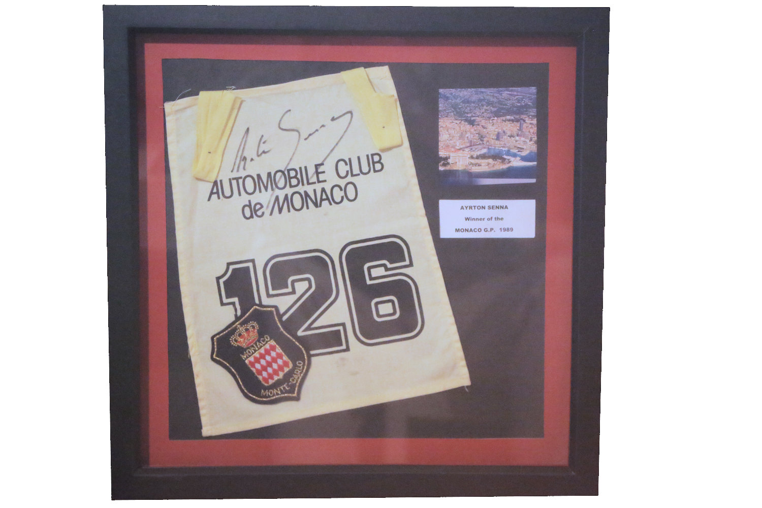 Lot 19 - Ayrton Senna: Framed Display from Monaco, signed