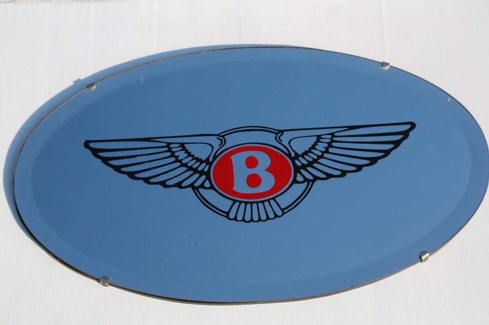 Lot 24 - Bentley: Modern Oval Showroom Mirror - 23 inches in diameter