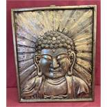 A large heavy metal wall hanging plaque depicting Buddha.
