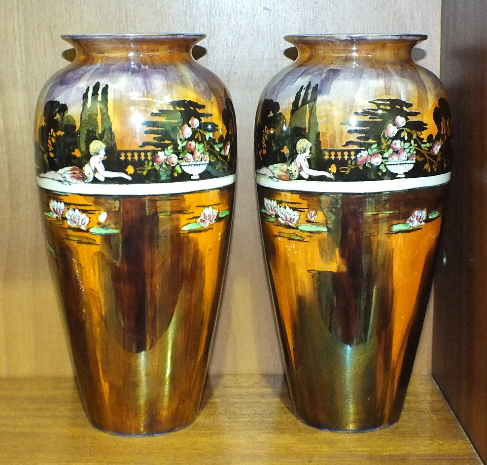 Lot 163 - A pair of Wilkinsons lustre 'Pans Garden' vases, of ovoid form, no.1018 to base, 27cm high, (2).