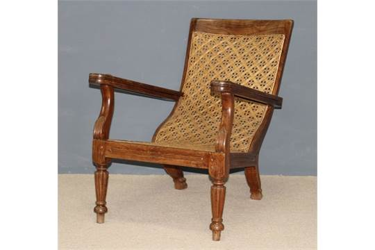 A Colonial rosewood plantation chair, with caned seat and back ...