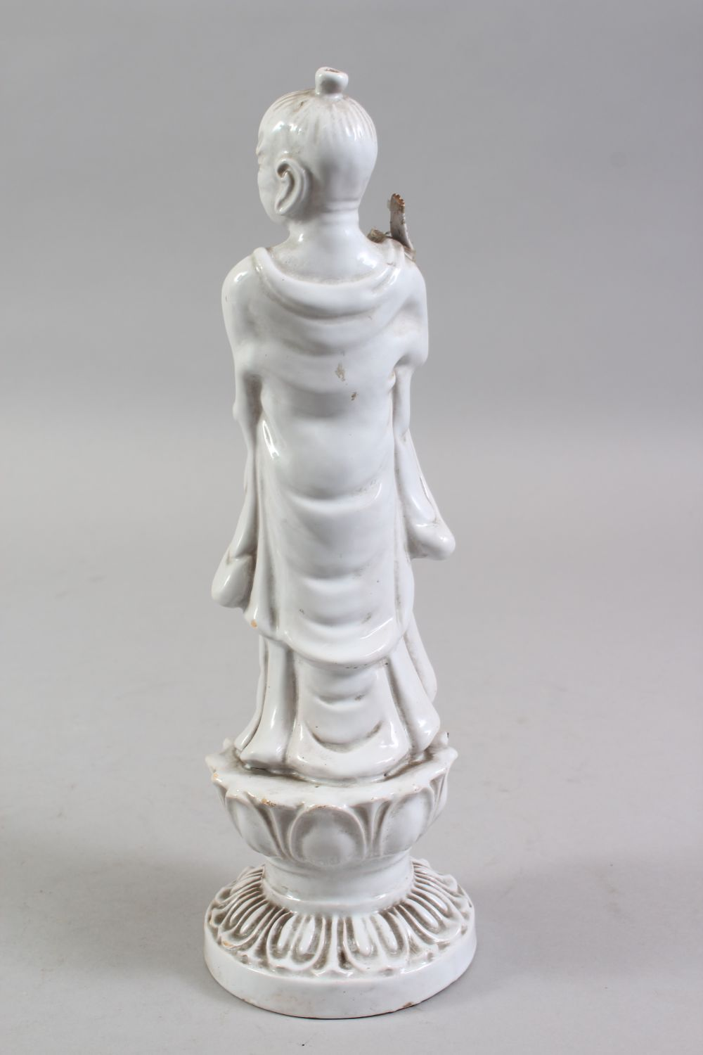 A CHINESE BLANC DE CHINE PORCELAIN FIGURE OF A BOY, standing holding a scepter, on a lotus base, - Image 3 of 6
