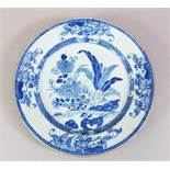 A 19TH CENTURY CHINESE BLUE & WHITE PORCELAIN PLATE, with native floral decoration, metal hanging
