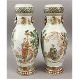 A GOOD PAIR OF JAPANESE MEIJI PERIOD KUTANI SATSUMA DECORATED VASES, with twin moulded floral
