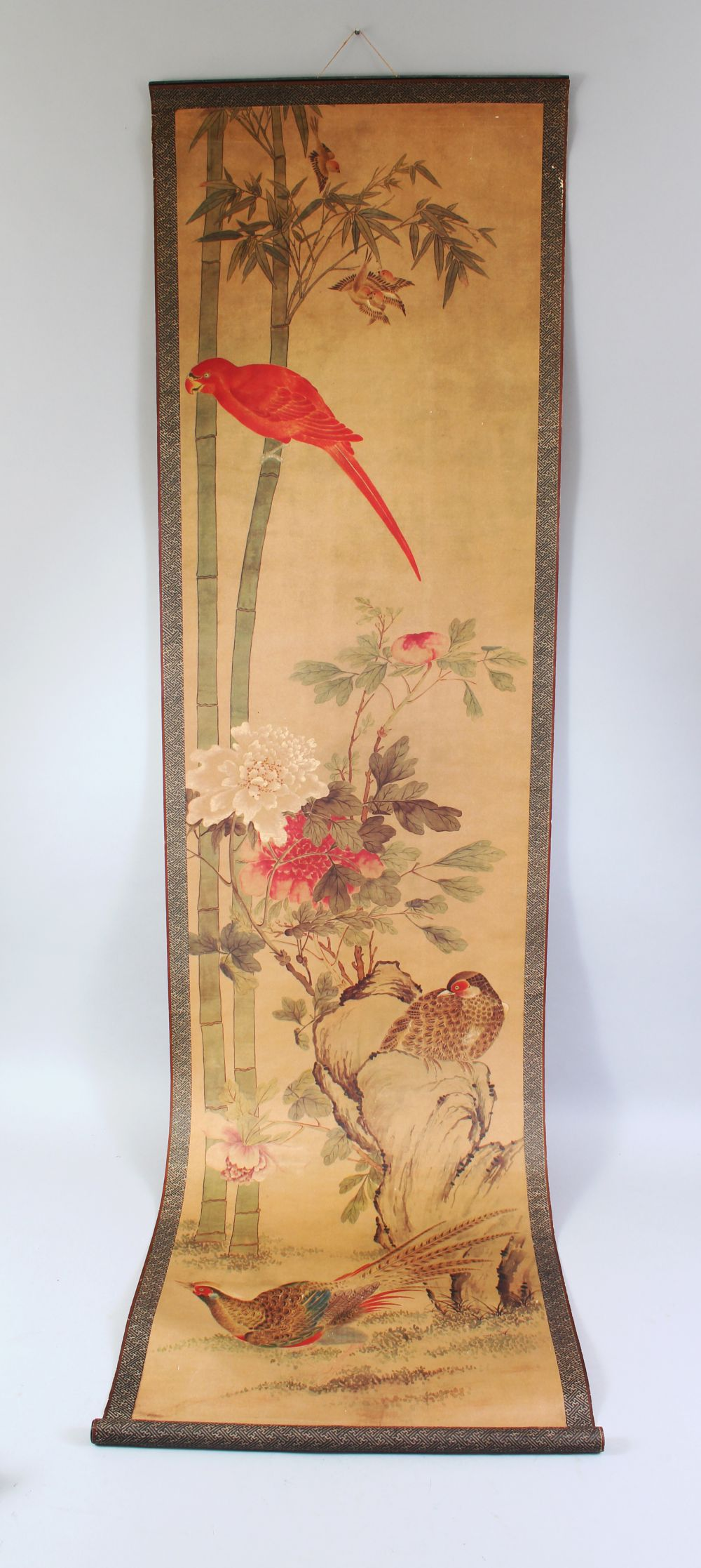 A 20TH CENTURY CHINESE PRINTED HANGING SCROLL PICTURE, depicting pheasants and other birds, 150cm