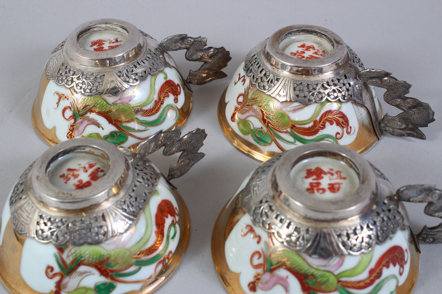 A SET OF FOUR 20TH CENTURY CHINESE FAMILLE ROSE PORCELAIN AND SILVER MOUNTED CUPS & SAUCERS, the - Image 7 of 8