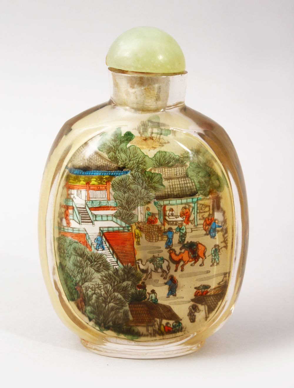 A GOOD 19TH / 20TH CENTURY CHINESE REVERSE PAINTED GLASS SNUFF BOTTLE, depicting scenes of figures