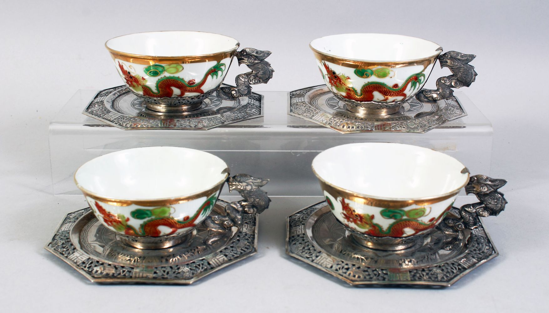 A SET OF FOUR 20TH CENTURY CHINESE FAMILLE ROSE PORCELAIN AND SILVER MOUNTED CUPS & SAUCERS, the