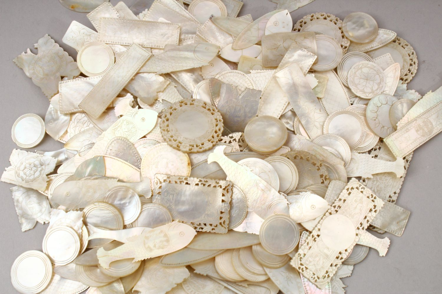 A QUANTITY OF 19TH CENTURY CHINESE CARVED MOTHER OF PEARL GAME COUNTERS, various styles an sizes. - Image 9 of 9