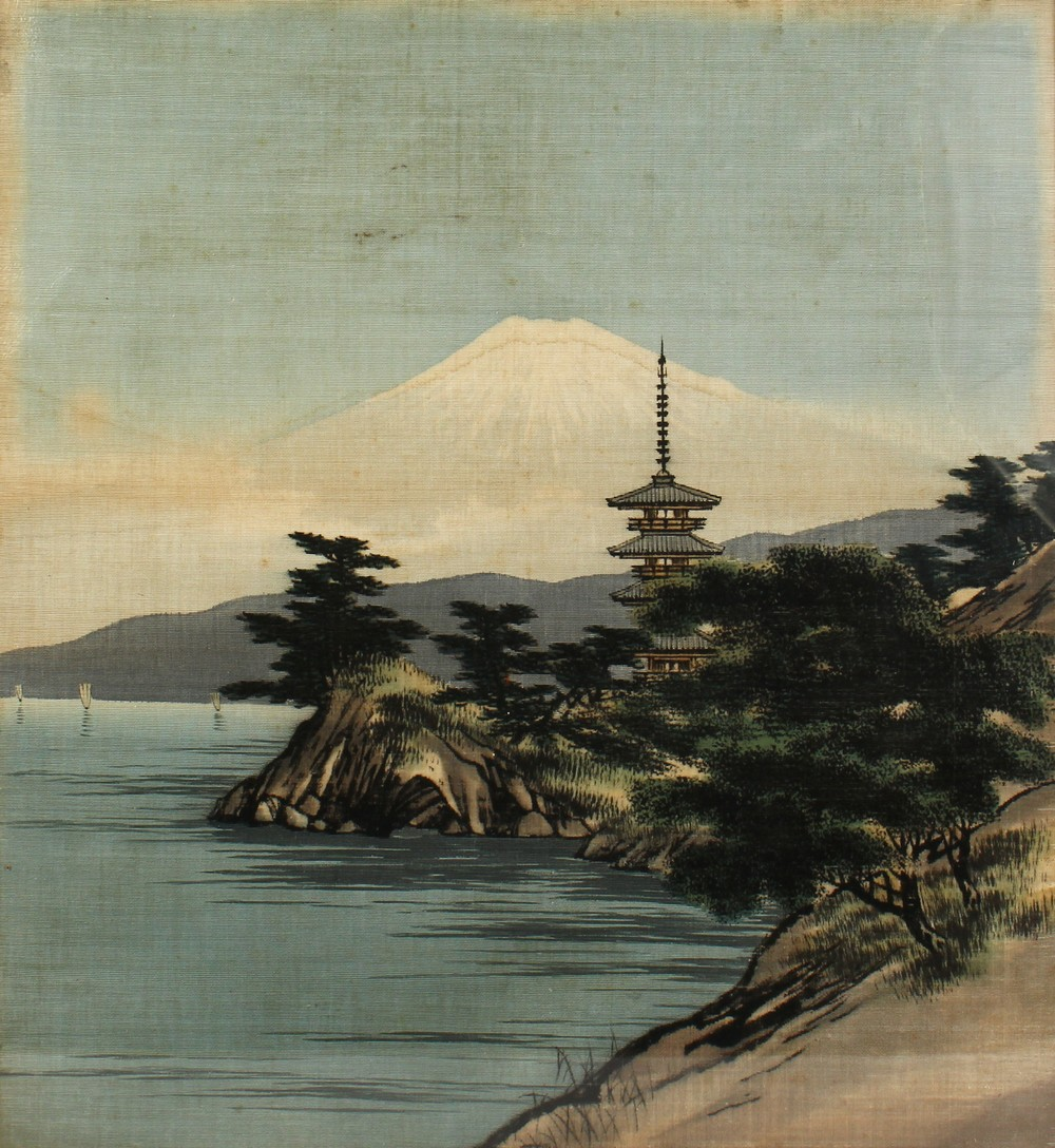 A 20TH CENTURY JAPANESE EMBROIDERED SILK PICTURE OF A LANDSCAPE VIEW, framed 62.5cm high x 52cm