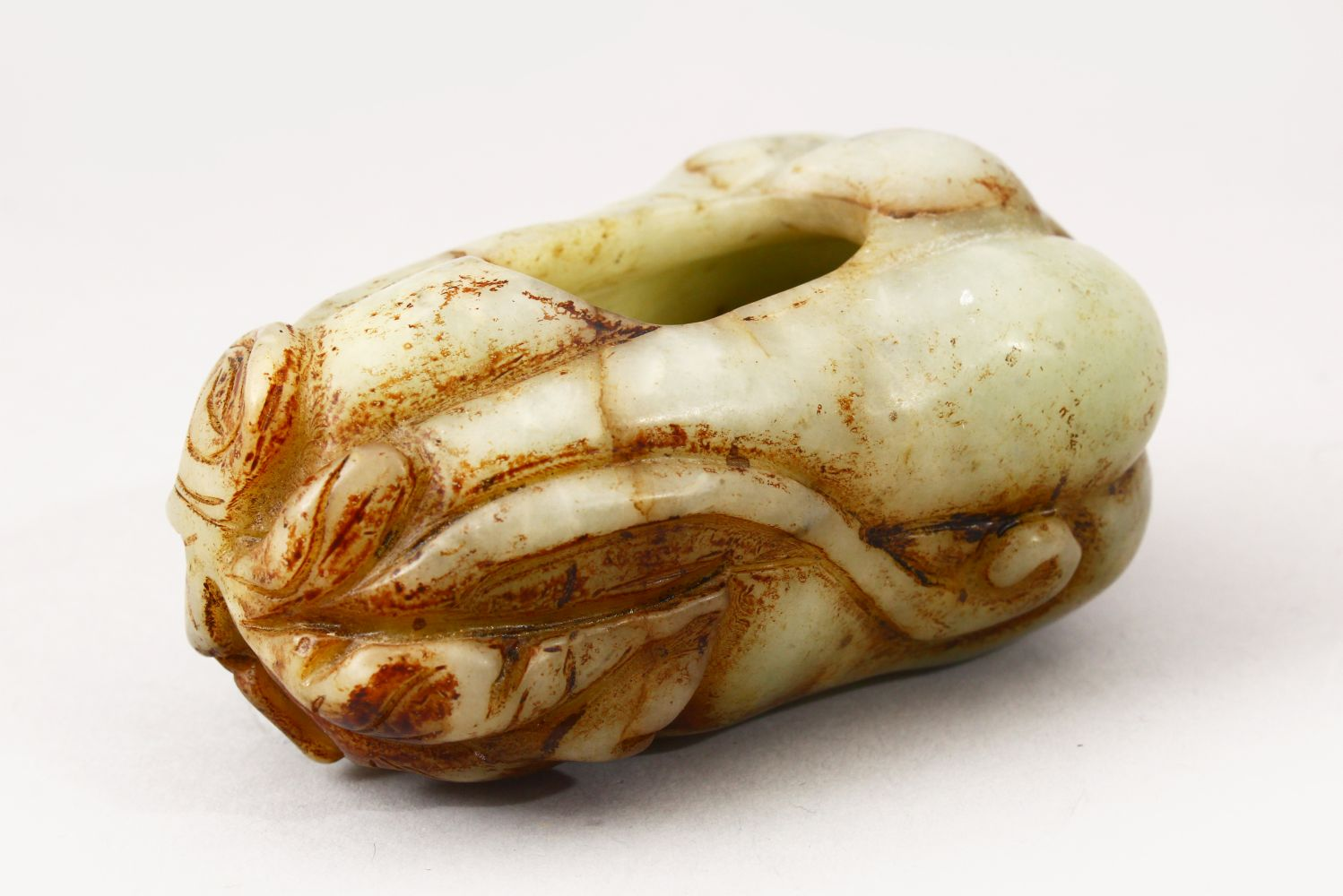 A GOOD 20TH CENTURY CHINESE CARVED JADE BRUSH WASH IN THE FORM OF A FRUIT, 9cm wide.