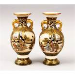 A GOOD PAIR OF SMALL JAPANESE MEIJI PERIOD SATSUMA TWIN HANDLE VASES, with panel decoration