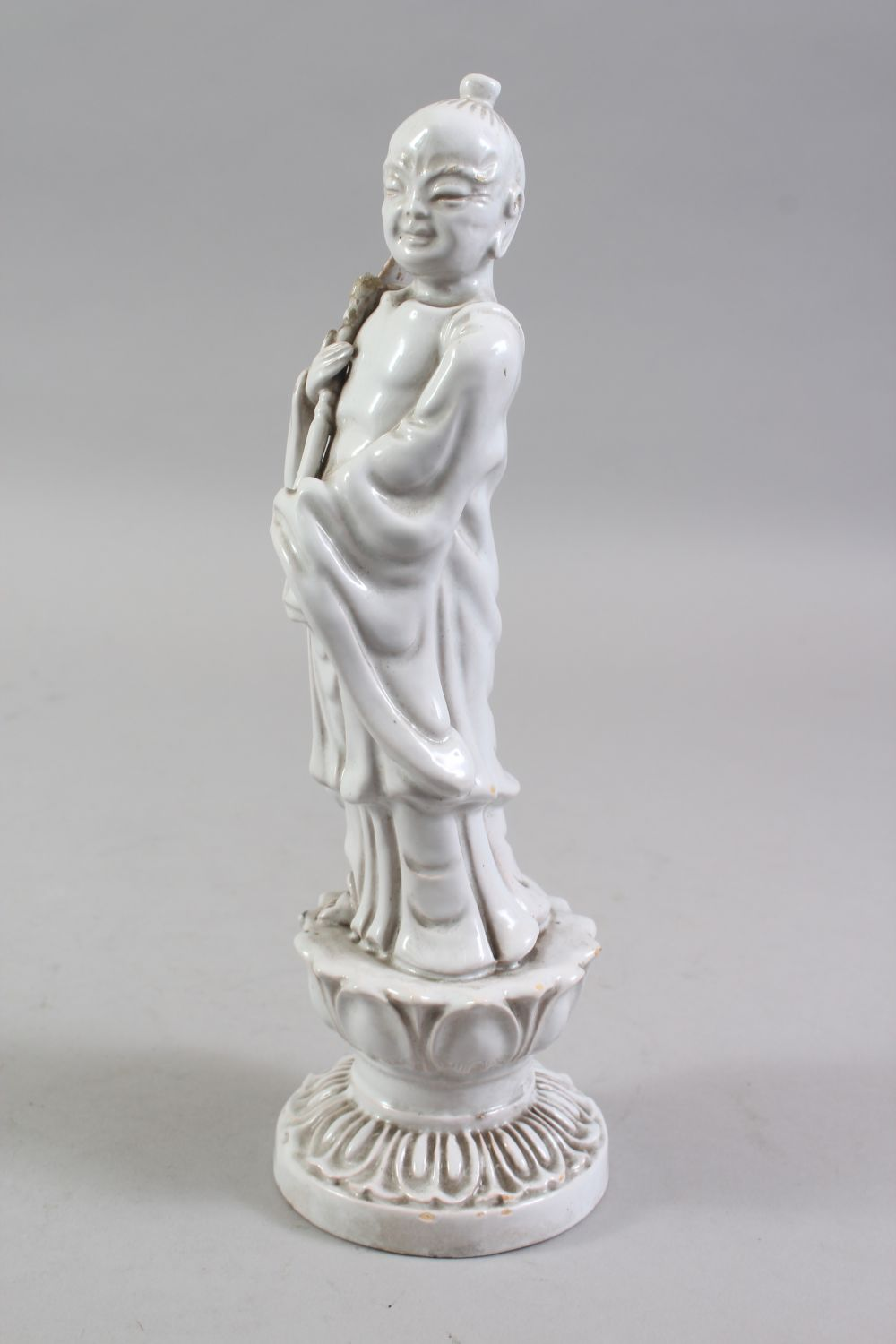 A CHINESE BLANC DE CHINE PORCELAIN FIGURE OF A BOY, standing holding a scepter, on a lotus base, - Image 4 of 6