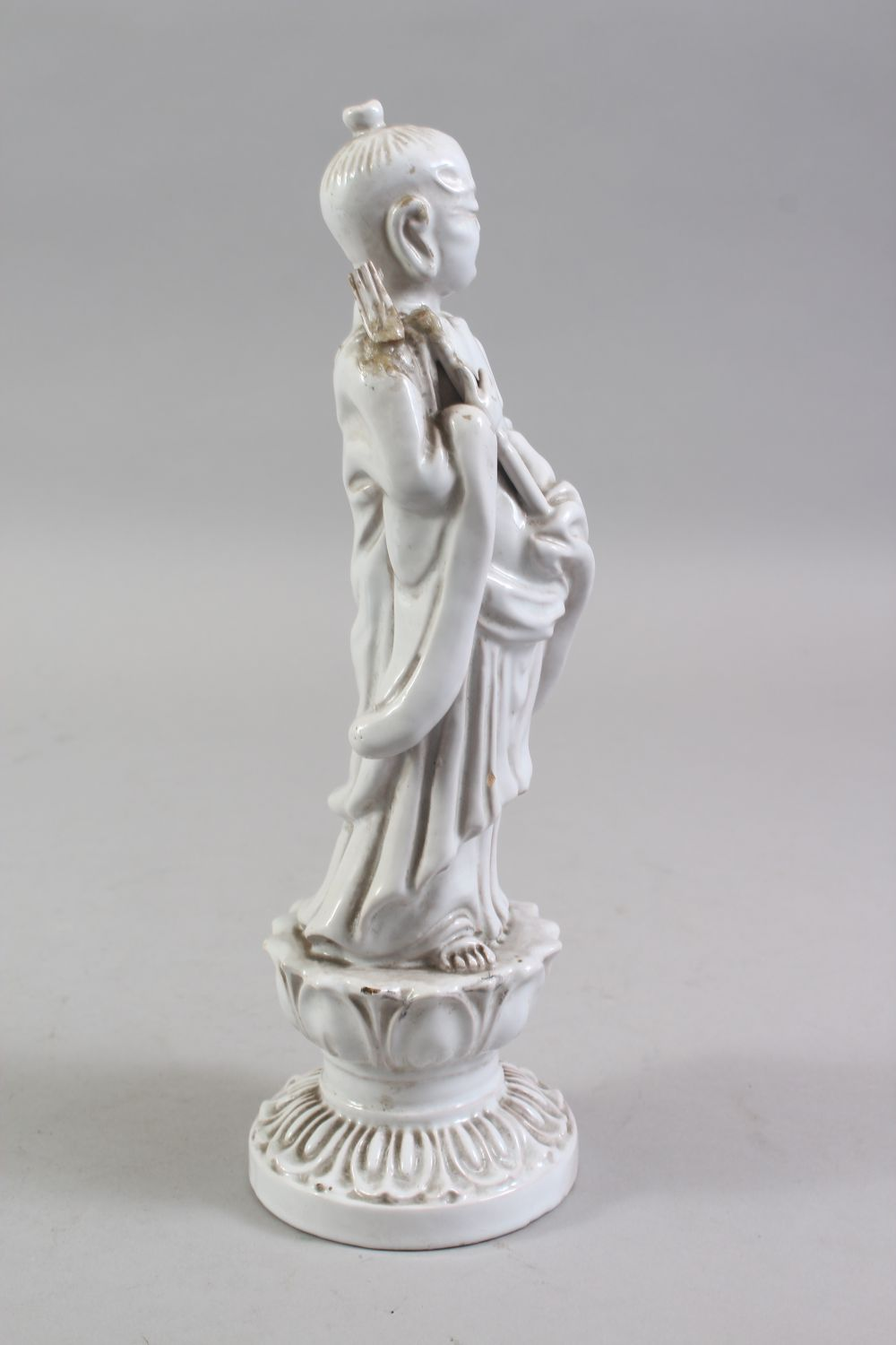 A CHINESE BLANC DE CHINE PORCELAIN FIGURE OF A BOY, standing holding a scepter, on a lotus base, - Image 2 of 6