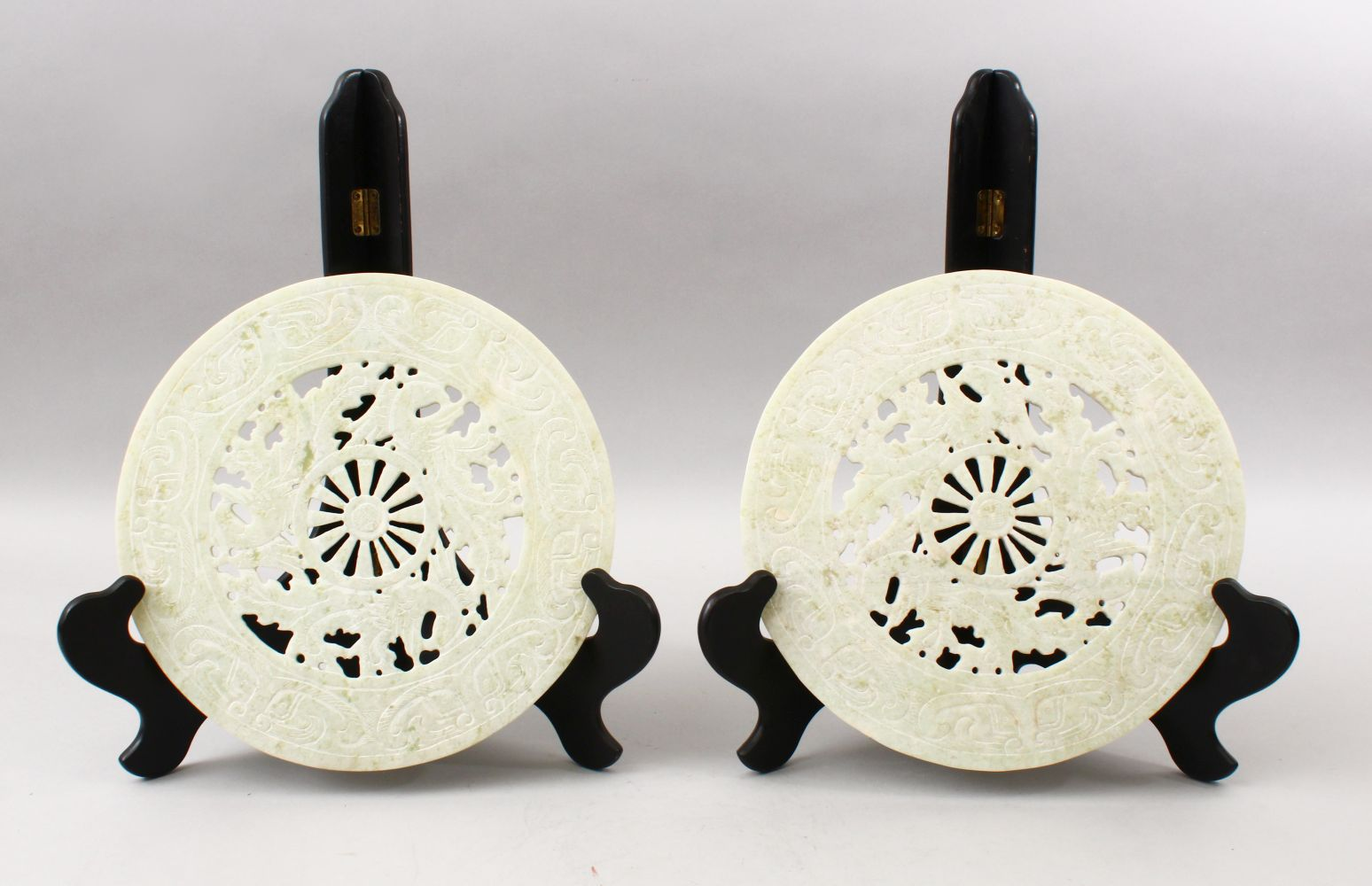TWO 20TH CENTURY CHINESE CARVED HARDSTONE / JADELIKE BI - DISKS, each disk carved with phoenix birds