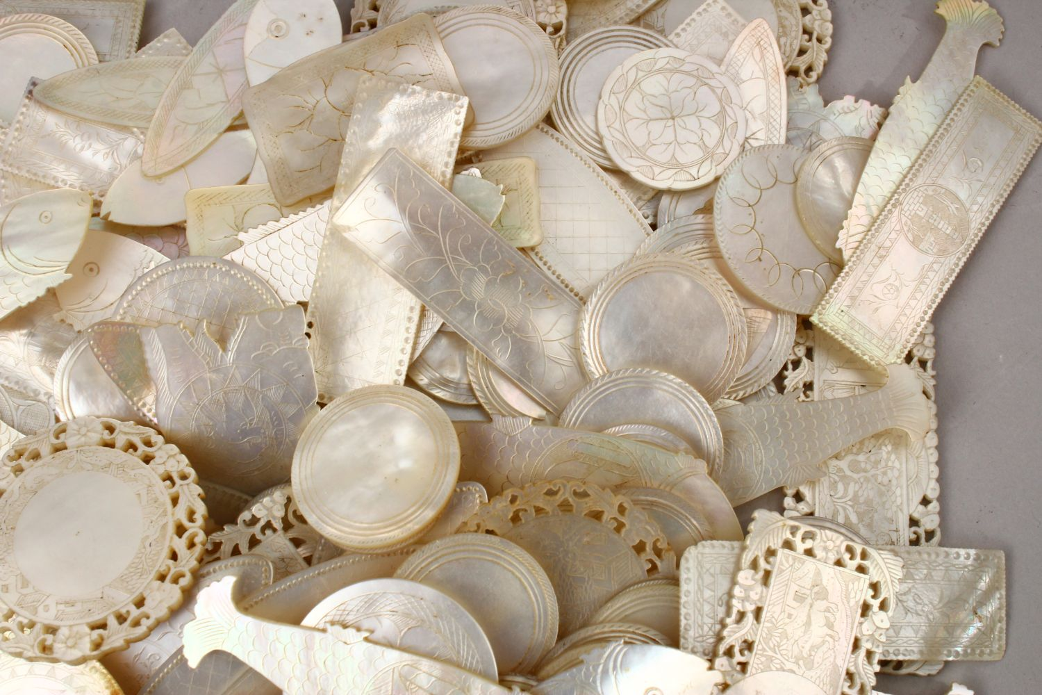A QUANTITY OF 19TH CENTURY CHINESE CARVED MOTHER OF PEARL GAME COUNTERS, various styles an sizes. - Image 7 of 9