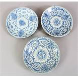 THREE 19TH CENTURY CHINESE BLUE & WHITE PORCELAIN PLATES, all with metal hanging brackets, the verso