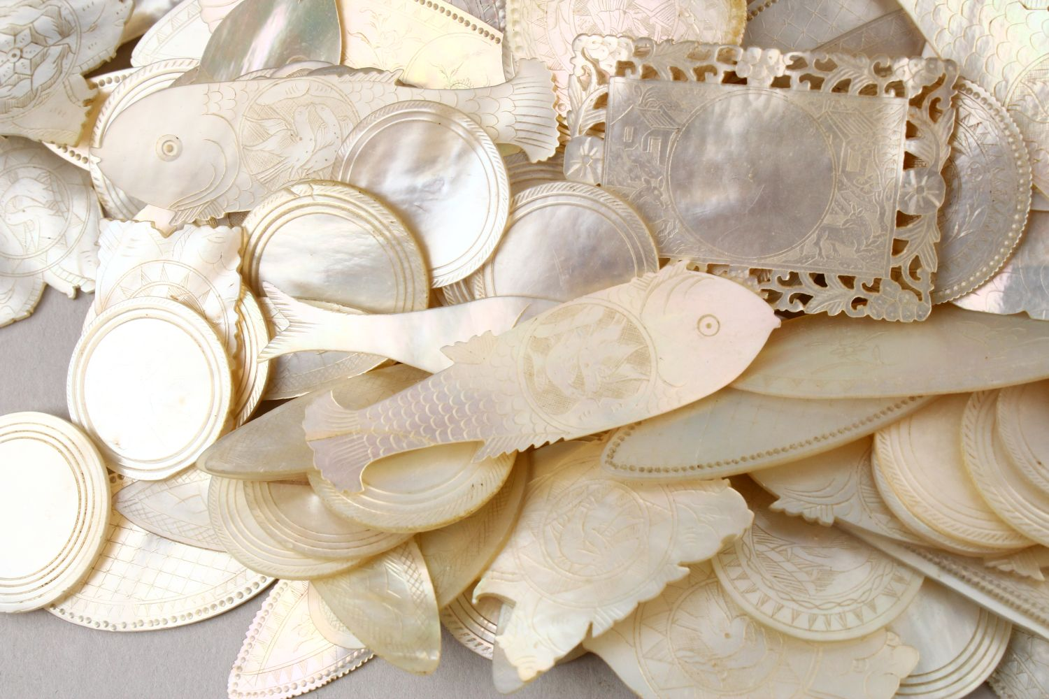 A QUANTITY OF 19TH CENTURY CHINESE CARVED MOTHER OF PEARL GAME COUNTERS, various styles an sizes. - Image 6 of 9