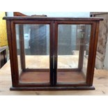 Lot 664 - A glass display cabinet 29 x 66 x 56cmH