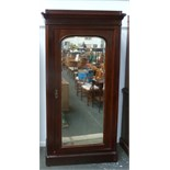 Lot 662 - A large wardrobe with central mirror,
