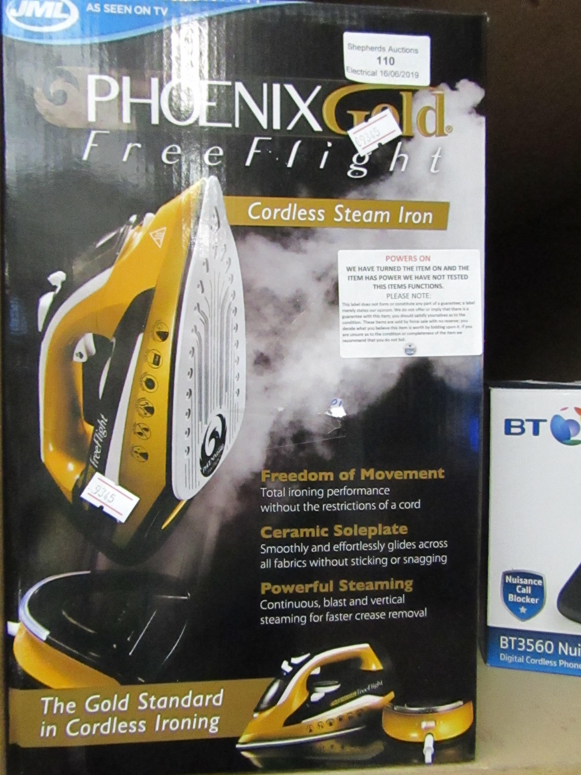 Lot 110 - JML Phoenix Gold Free Flight cordless steam iron, powers on and boxed.