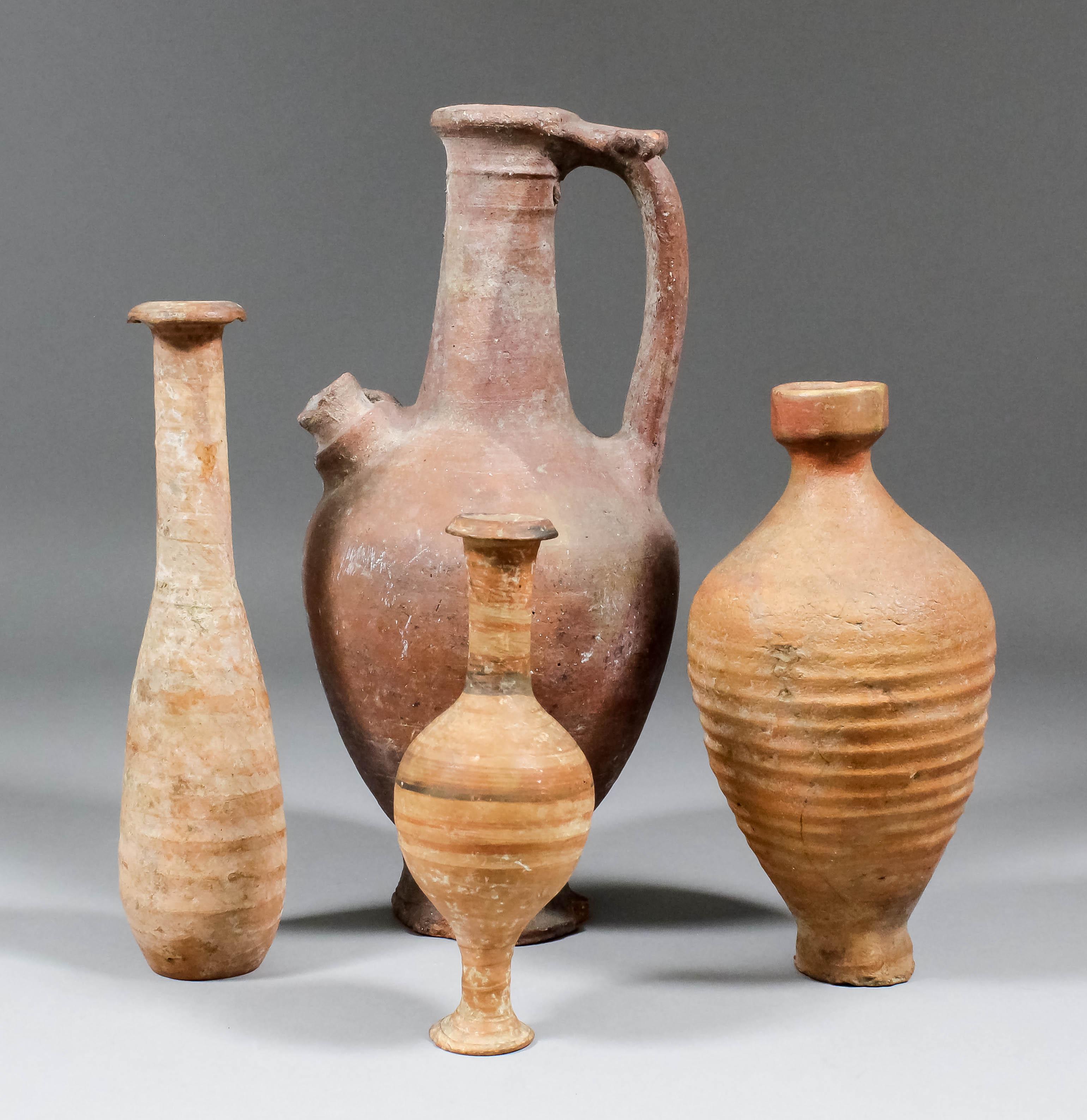 A roman pottery unquentarium 825ins high a small pottery vase lot 452 a roman pottery unquentarium 825ins high a small pottery vase reviewsmspy