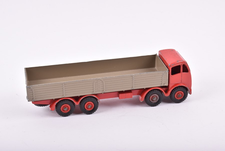Lot 28 - Two loose and playworn 905 Dinky Foden Flat Truck with Chains in green and maroon, together with