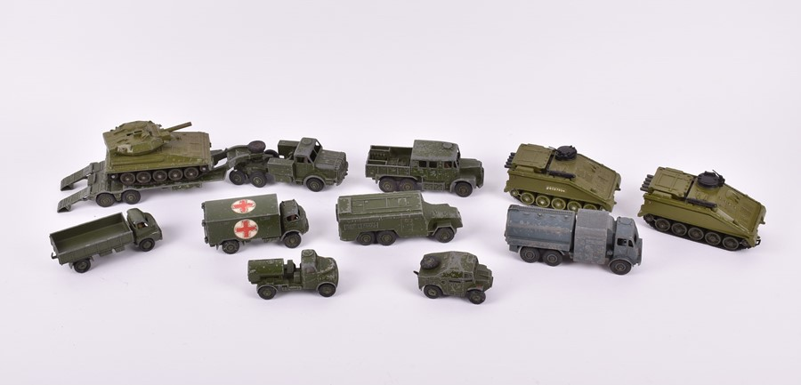 Lot 25 - Eleven assorted loose and playworn Dinky diecast military vehicles comprising: a 626 Military