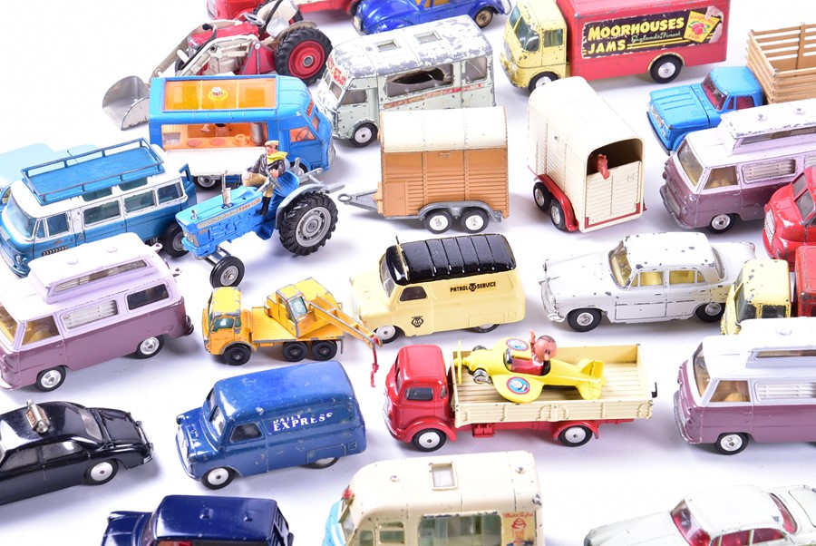 Lot 64 - A large quantity of loose and playworn Corgi Toys diecast vehicles to include advertising vans,