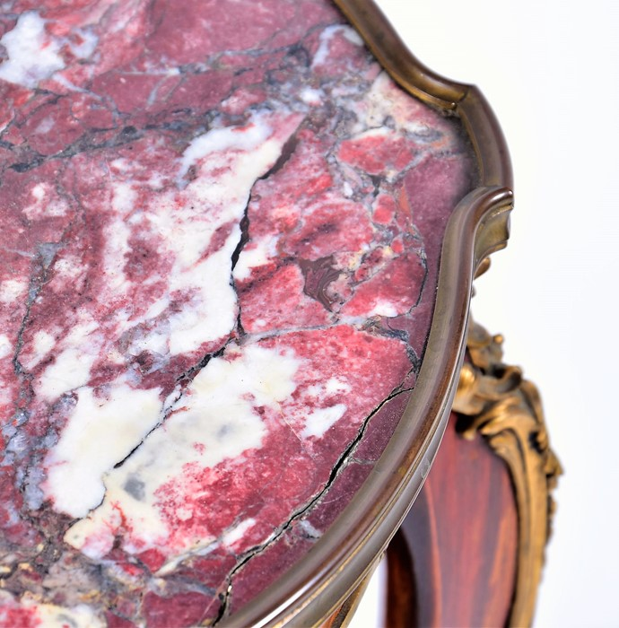 Lot 103 - A French Louis XV style ormolu mounted side table with purple veined marble top above an ormolu