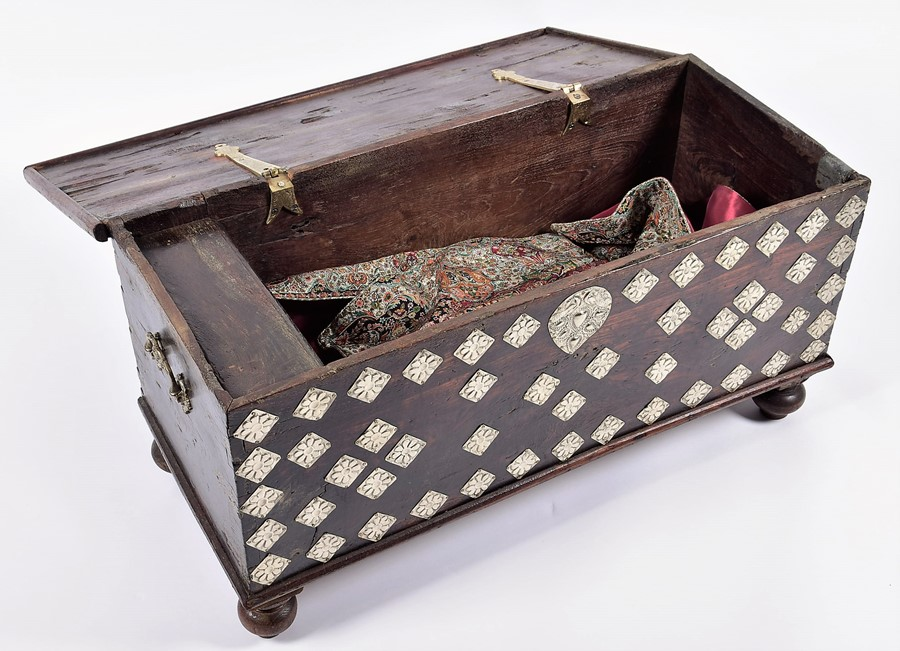 Lot 127 - A small Eastern coffer or blanket box with applied white metal decoration, on bun feet, 88 cm x 39